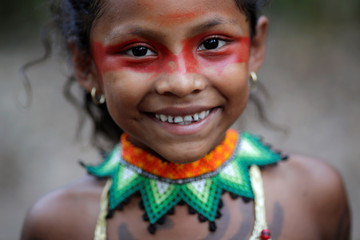 An Indigenous girl from the Shanenawa tribe poses for a photo during a festival in the indigenous village of Morada Nova near Feijo
