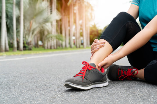 fitness woman runner feel pain on ankle leg. Outdoor exercise activities concept