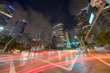 Fototapeta Brickell Avenue business district at night with trailing car lights