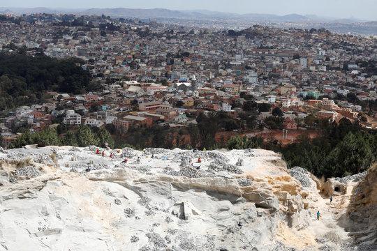 People work at a quarry near the Akamasoa community in Antananarivo