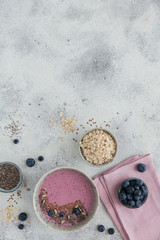 Healthy breakfast with pink yogurt smoothie bowl made with berry and seeds