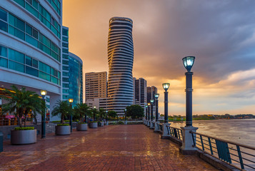 Fotomurales - Cityscape of Guayaquil city at sunset with a view over the Malecon 2000 waterfront, the Guayas river and the point skyscraper after a thunderstorm, Ecuador.