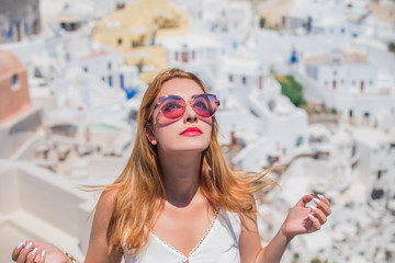 Woman in trip, Picturesque view of traditional Santorini streets, Location: Oia village, Santorini,...