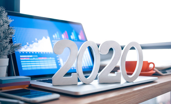 2020, smart goal concepts with mock up text number on computer laptop on desk table and window office background