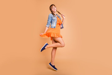 Wall Mural - Full length photo of attractive lady jumping high wear casual outfit isolated beige background