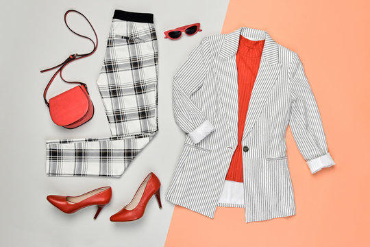 Autumn Arrives. Fashion Lady Clothes fall Outfit. Trendy jacket, trousers. Stylish red Handbag, Glamour heels, fashionable mood. Creative design autumnal Accessories Flat lay, coral color