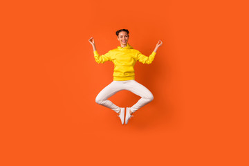 Full size photo of cheerful pretty lady doing exercise meditating showing om sign wear hood isolated over orange background Wall mural