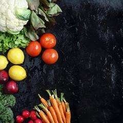 Fresh Veggies display on a black slate background