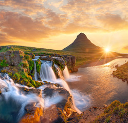 Spoed Foto op Canvas Beige Beautiful landscape with sunrise on Kirkjufellsfoss waterfall and Kirkjufell mountain, Iceland, Europe.