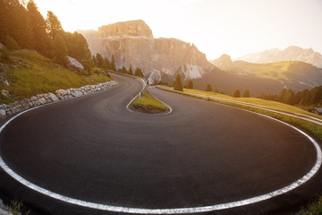 Asphalt road in Dolomites in a summer day, Italy.