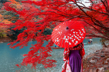 Photo on textile frame Red Travelers wear a kimono to see the beauty of autumn
