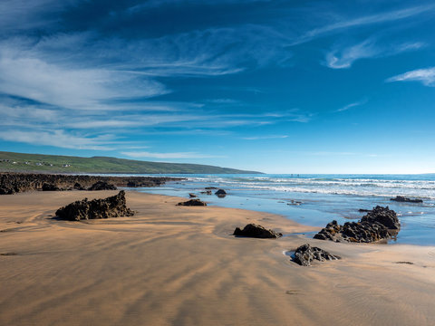 Beautiful Fanore beach county Clare, Ireland, Blue cloudy sky, and ocean water, Stretch of yellow sand.
