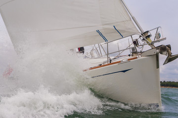 Sailing Boat Yacht in Rough Sea Waves