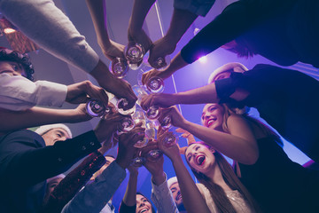 Low below angle view of nice attractive cheerful cheery girls and guys having fun rest relax clinking wineglass congrats corporate event feast celebratory in luxury place nightclub lights indoors Fototapete