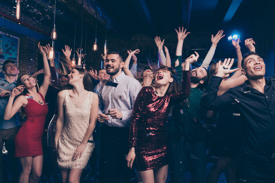 Portrait of charming attractive millennial motion having scream shout rejoice raise hands free time indoors discotheque dress suit formalwear hairstyle