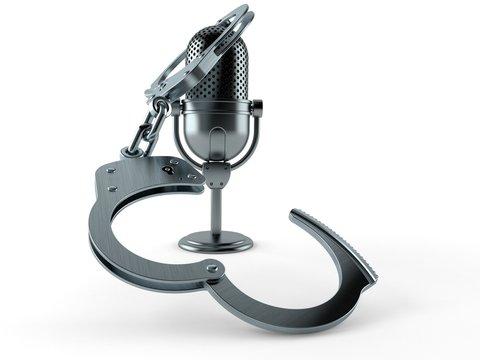 Radio microphone with handcuffs