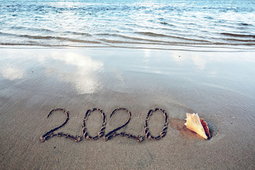 New Year 2020 is coming concept on tropical beach.