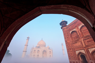 Taj Mahal in the fog at Indian city of Agra, Uttar Pradesh, India.