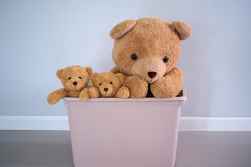 A group of brown-haired teddy bears in a pink box. Background for children