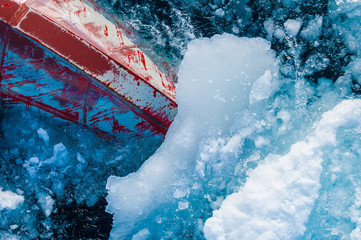 Bow of ice breaker going through ice in the Arctic Circle.