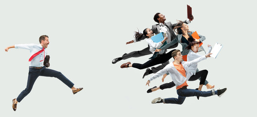 Happy office workers jumping and dancing in casual clothes or suit with folders on white. Ballet dancers. Business, start-up, working open-space, motion and action concept. Creative collage. Wall mural