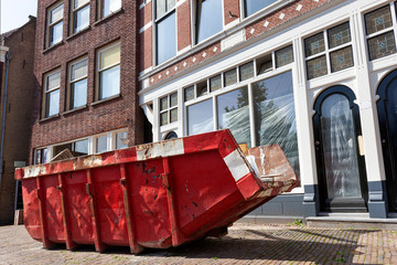 Red skip in a street in Rotterdam