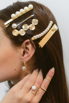 Stylish hairpins for a dark-haired girl. Pearl Earrings