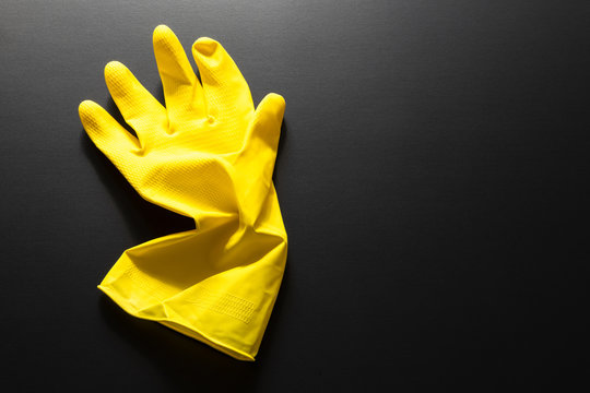 yellow rubber glove isolated on black background