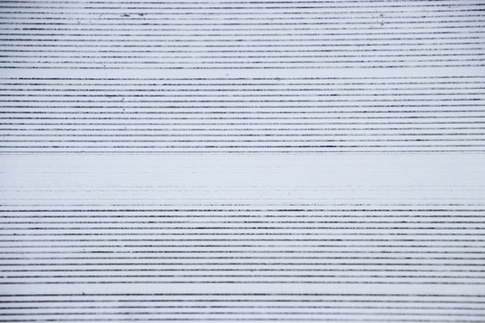 View directly overhead of pattern on metal bleachers in stadium of local high school
