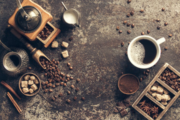 Fototapete - Coffee cup with coffee grinder and coffee beans on dark textured background.