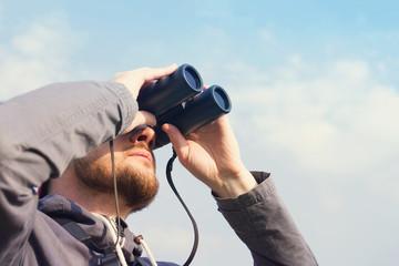 Fototapeta Man with the field-glass watches birds. Ornithology. Birdwatching obraz