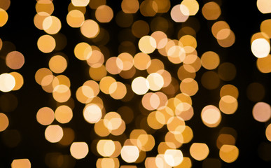 Fotobehang - christmas and holidays concept - blurred golden lights bokeh on black background