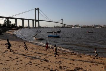 Children play beneath the Katembe Bridge, ahead of Pope Francis's visit to Maputo