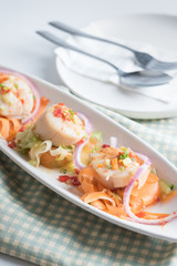 Scallops with spicy seafood sauce