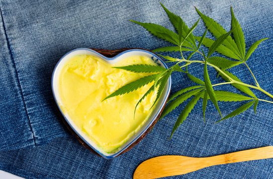 Butter with cannabis plant in a heart shape bowl