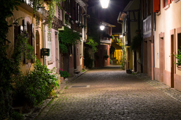 Beautiful colorful street of medieval village Kaysersberg at night. Alsace. France.
