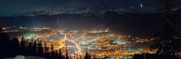 Aerial panorama of Zakopane and Tatry mountains at night