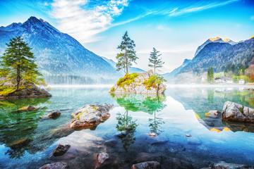 Lake Hintersee in Germany, Bavaria, National Park Ramsau in Alps. Beautiful autumnal Alpine landscape, amazing light during sunrise. Incredible seasonal autumn scenery. Famous landmark in Germany.