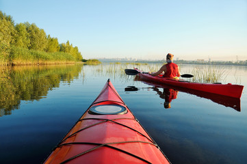 Two people kayaking on the river