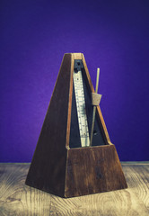Vintage wooden metronome used to keep tempo in music