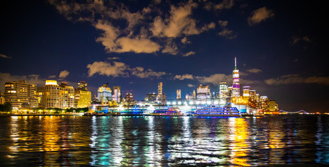 Wall Mural - New York City skyline towards lower Manhattan Financial District at night with lights