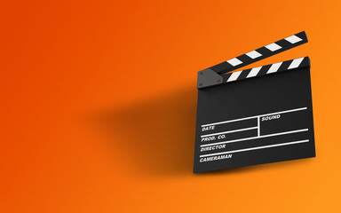 Empty Clapperboard with Message Area Against Orange