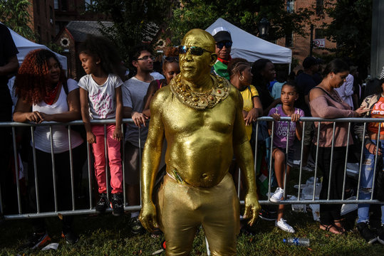 A man dressed in gold paint participates in the annual West Indies Day parade in the borough of Brooklyn in New York City