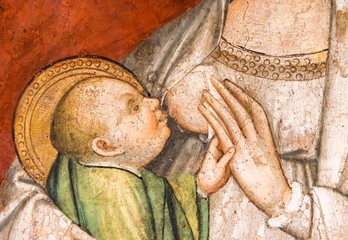 Detail of medieval painting showing Mary breast feeding baby Jesus