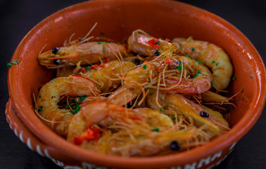 Grilled shrimp, Portuguese style with crushed chili peppers, garlic and parsley at an al fresco restaurant in Porto
