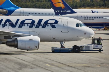 OSLO, NORWAY - MAY 3, 2015: Airliner of Finnair taxiing at Oslo Gardermoen airport. Pushed back by towtruck