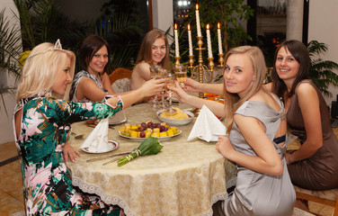 cheerful friends at a festive table