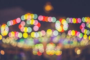 Spoed Fotobehang Carnaval blur of light at carnival festival night market