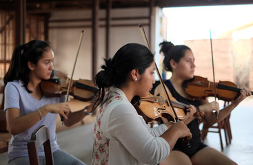 Young women practise baroque music at the Jesuits Missionary complex which has been declared by UNESCO as a World Heritage Site in Concepcion