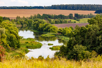 Foto op Canvas Meloen Beautiful landscape with a river and trees in summer